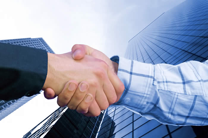 bigstockphoto_Corporate_Deal_-_Blue_Handshak_104958_002